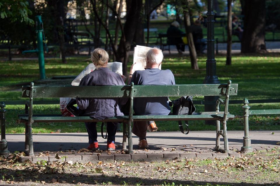 Older demographic reading newspaper