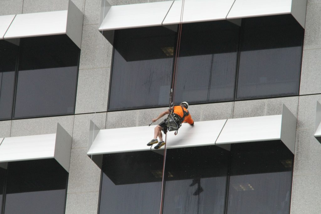 Window cleaning a skyscraper